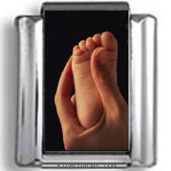Baby Foot in Parent's Hand Photo Charm